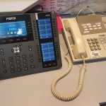 School reception phone and paging handset upgraded into one easy to use product